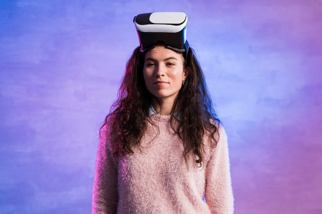 Woman wearing a virtual reality googles on her head Free Photo
