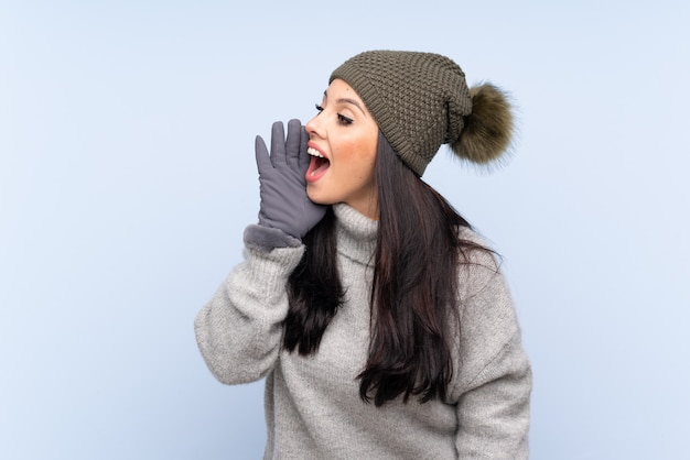 Woman wearing winter clothes over isolated wall Premium Photo