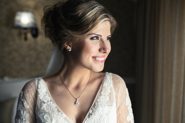 Woman in wedding dress smiling Free Photo