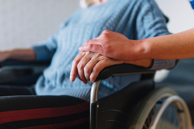 Woman in wheelchair in old age home Free Photo