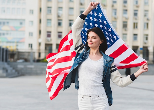 Woman in white clothes with american flag on street Free Photo