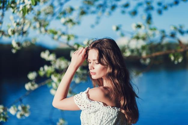 Woman in white dress outdoors Premium Photo
