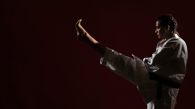 Woman in white karate uniform and copy space background Free Photo