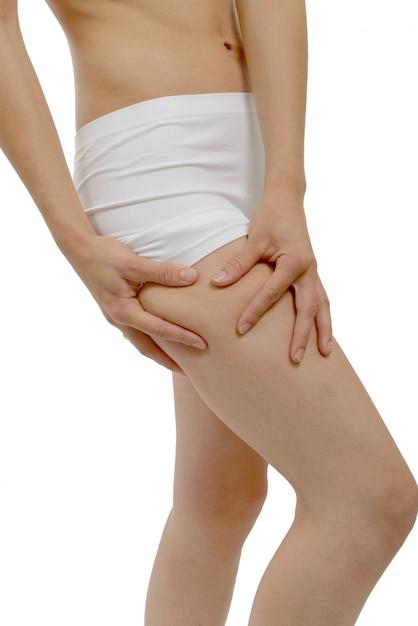 Woman in white underwear showing slimming concept Premium Photo