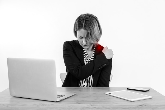 Woman with aching shoulder office 23 2147768295
