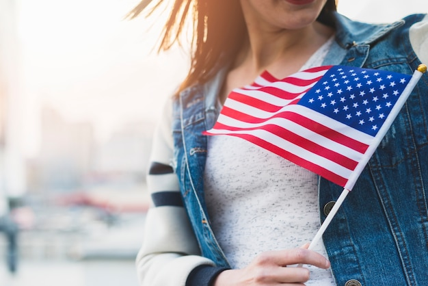 Woman with american flag on stick in hand Free Photo