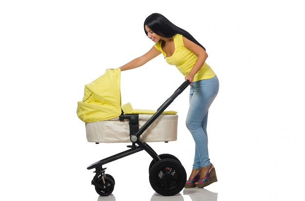 Woman with baby and pram isolated on white Premium Photo