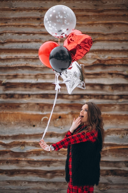 Woman With Balloons On Her Birthday Outside Free Photo