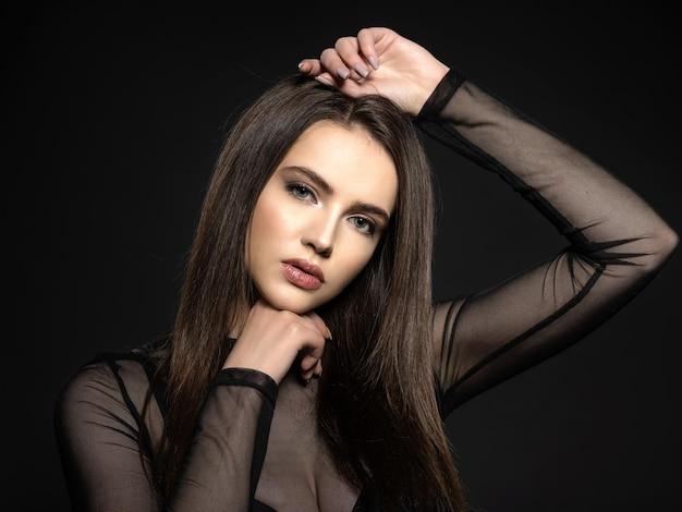 Woman with beauty long brown hair. fashion model with long straight hair. fashion model posing . pretty woman with long straight brown hair Free Photo