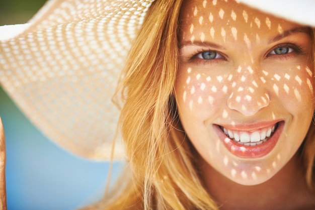 Woman with a big smile close-up Free Photo