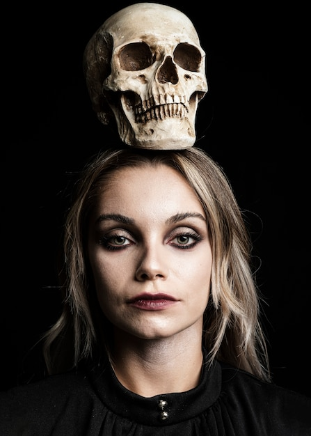 Woman with blonde hair and skull Free Photo