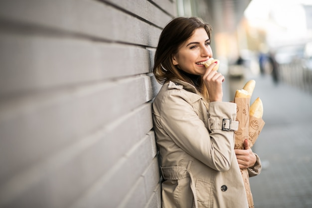 Woman with bread Free Photo