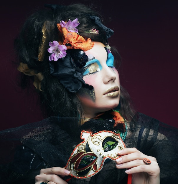 Woman with bright make up with carnival mask Premium Photo