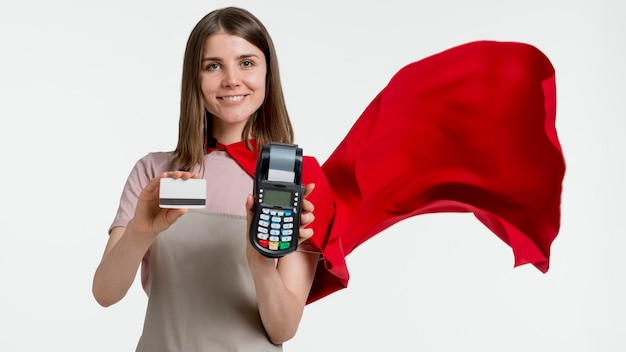 Woman with cape holding pos and card Free Photo