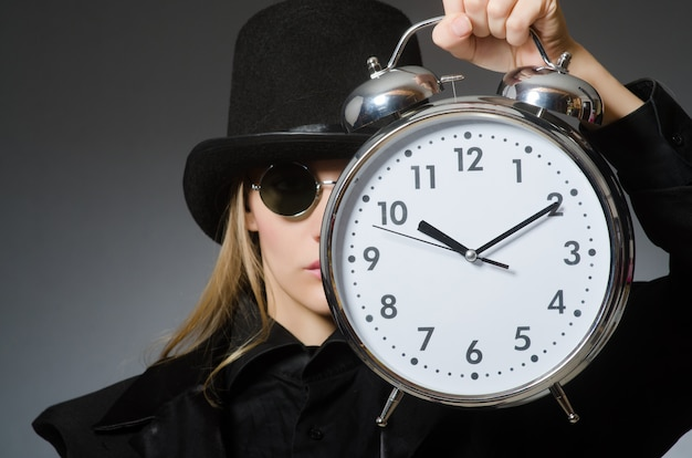 Woman with clock in business concept Premium Photo