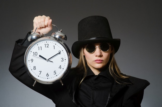 Woman with clock in business Premium Photo