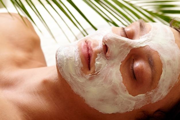 Woman with closed eyes and cream lotion on face Free Photo