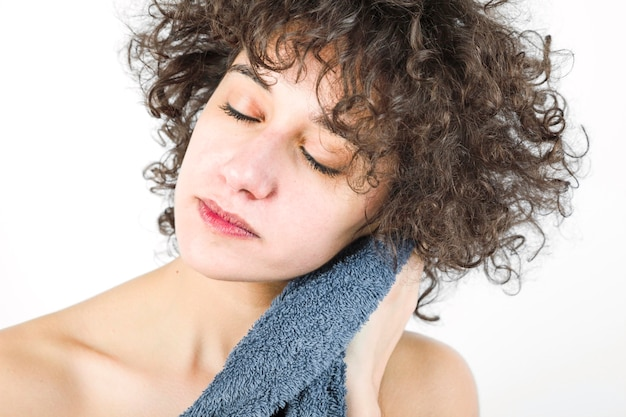 Woman with closed eyes wiping herself with towel Free Photo