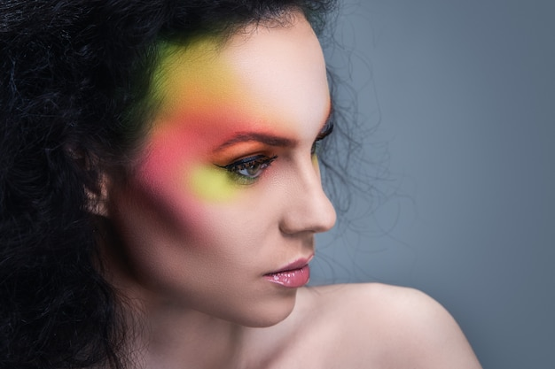Woman with colored make-up Free Photo