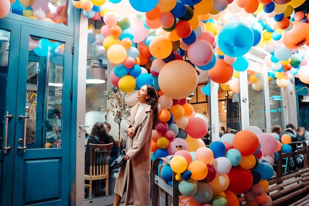 Woman with colorful balloons Free Photo