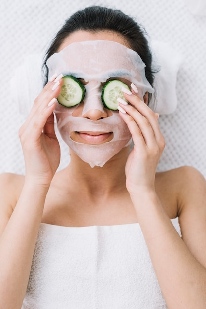 Woman with a cucumber mask Free Photo