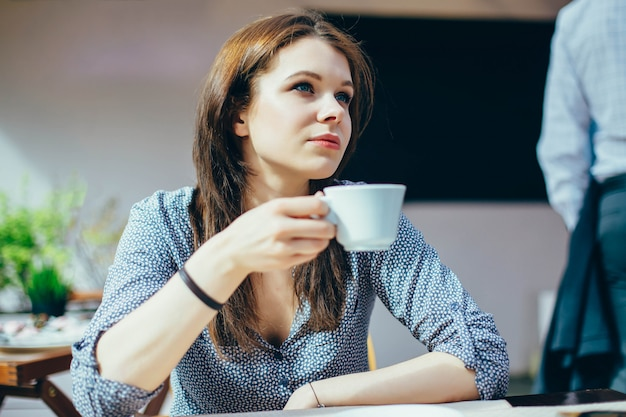 Woman with a cup of coffee Premium Photo