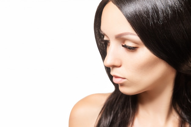 Woman with dark shiny hair and long brown eyelashes Premium Photo