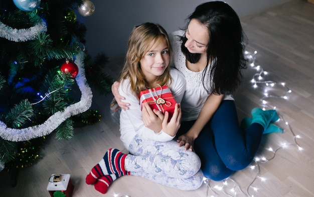 Woman with daughter at christmas tree Free Photo