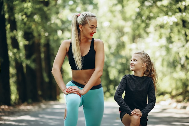 Woman with daughter jogging in park Free Photo