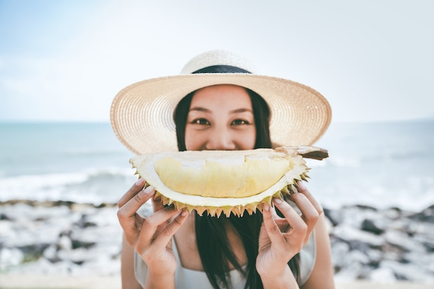 Woman with durian Premium Photo