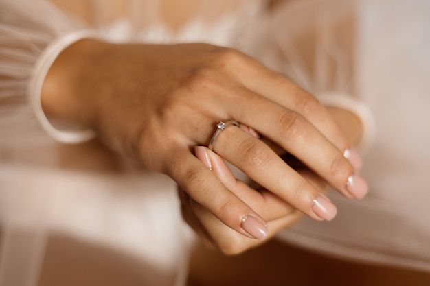 Woman with engagement ring with diamond and beautiful manicure Free Photo