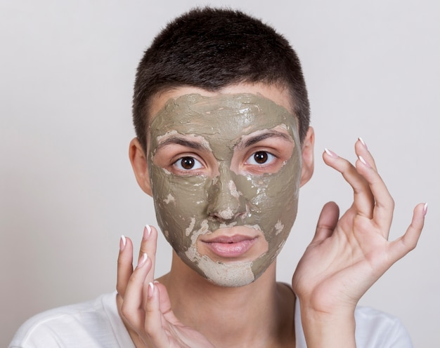 Woman with face mask looking at the camera Free Photo