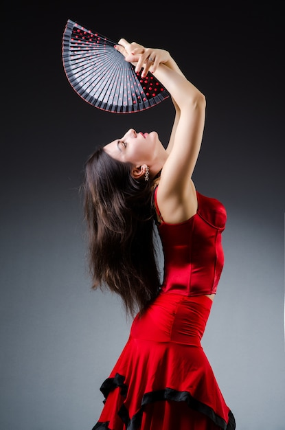 Woman with fan dancing dances Premium Photo