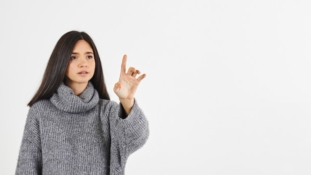 Woman with forefinger raised Free Photo