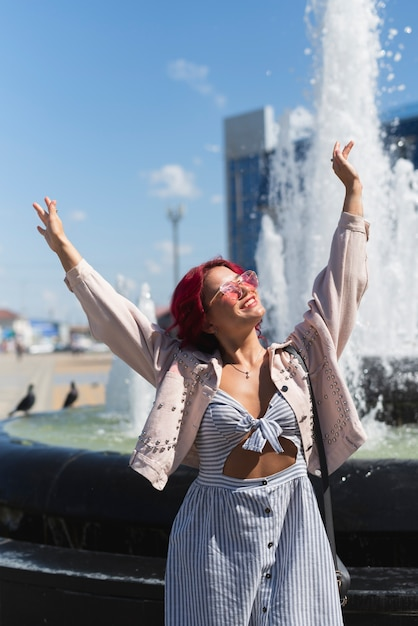 Woman with fountain water background Free Photo