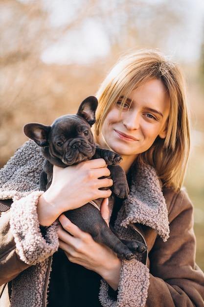 Woman with french bulldog Free Photo