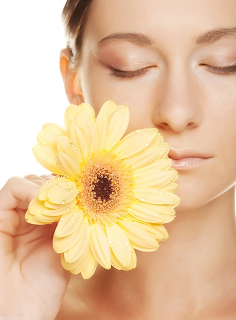 Woman with gerber flower Premium Photo