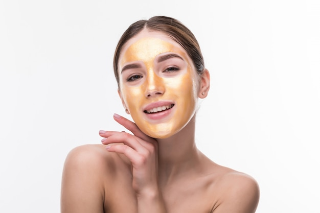 Woman with gold mask. beautiful woman with golden mask on face skin cosmetic touch face. beauty skincare and treatment Free Photo
