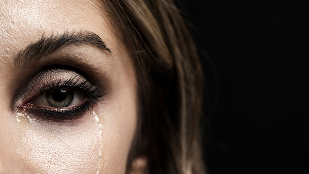 Woman with green eyes crying Free Photo