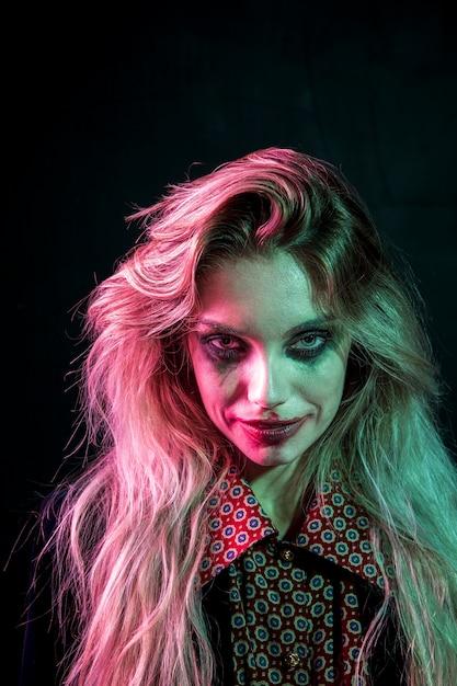 Woman With Halloween Joker Makeup Looking At Camera Photo
