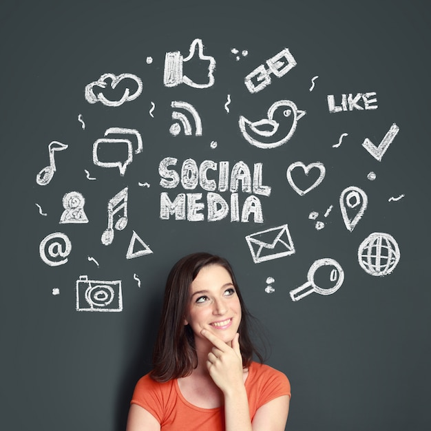 Woman with hand drawn illustration of social media concept Premium Photo
