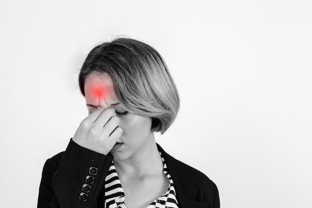 Woman with headache in studio Free Photo