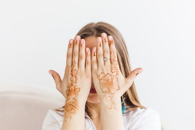Woman with henna drawing on hands, mahendi Premium Photo