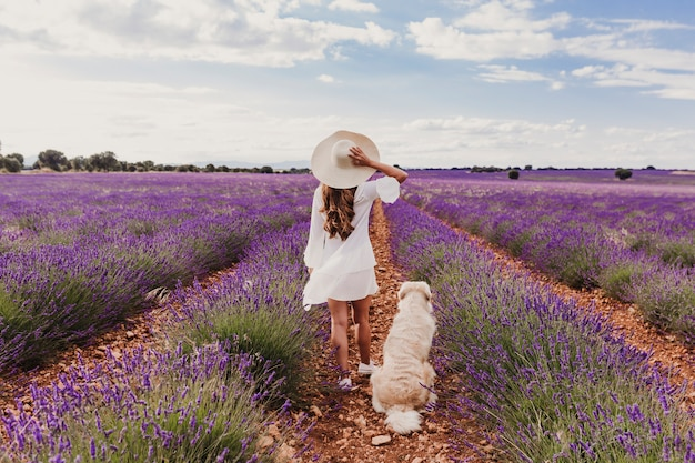 Woman with her dog in lavender fields Premium Photo