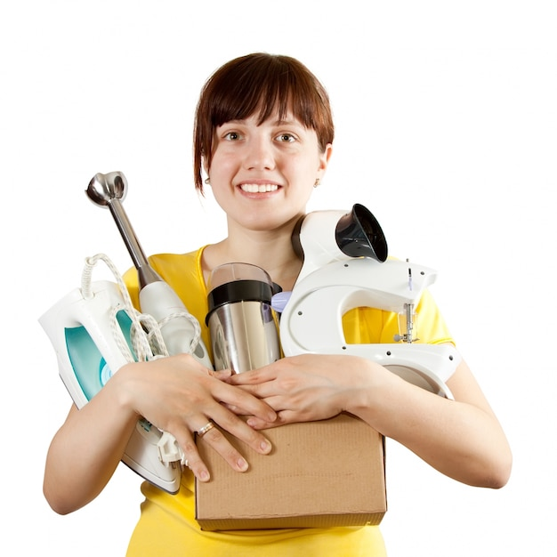 Woman with household appliances over white Free Photo