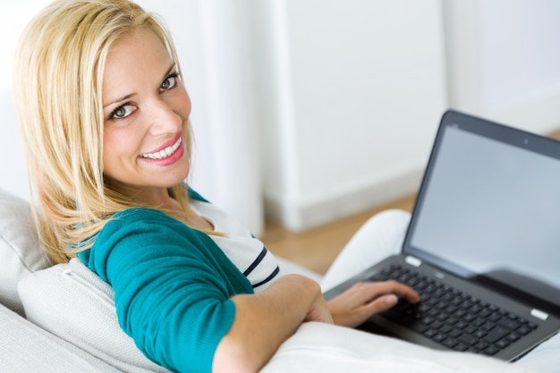 Woman with laptop looking at camera Free Photo
