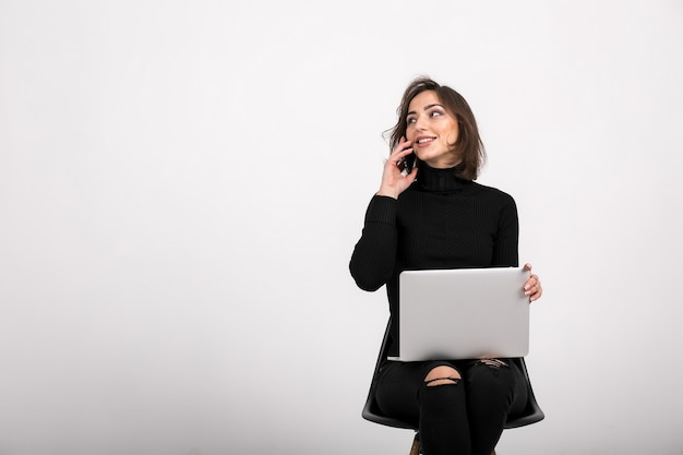 Woman with laptop sitting isolated Free Photo