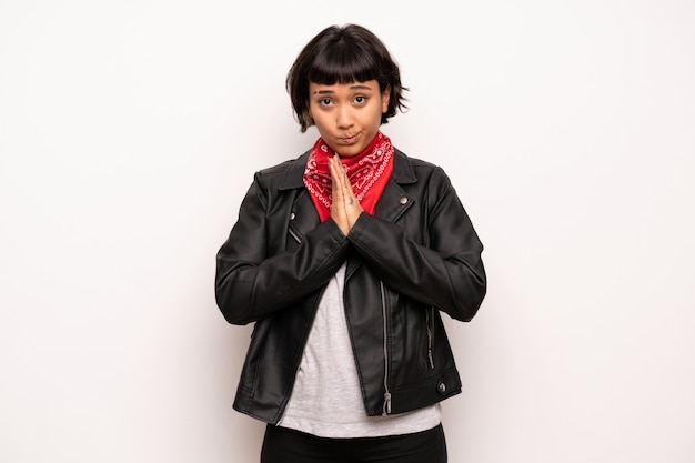 Woman with leather jacket and handkerchief keeps palm together Premium Photo