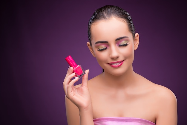 Woman with lipstick tube in beauty concept Premium Photo