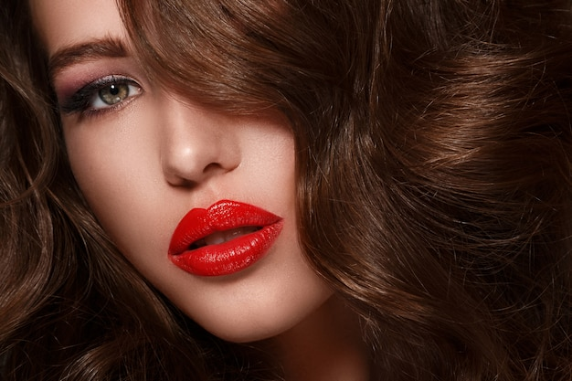 Woman with long glossy hair Premium Photo
